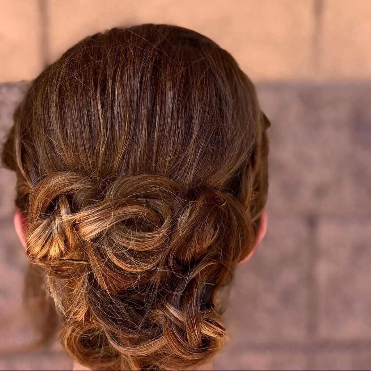 Updo by Karsyn Bigelow at Design Ramon Hair Studio